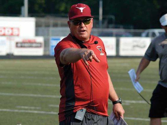 New football coach Maxwell mug