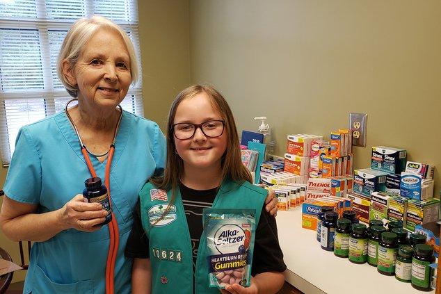 A-Girl Scout donates to GSC pic 2.jpg