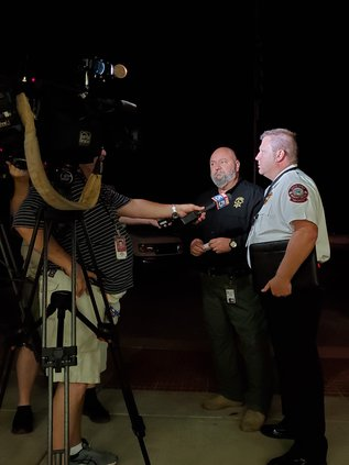 Sheriff Jeff Johnson and Fire Chief Danny Thompson brief the press