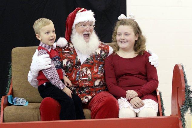excited kids meet santa